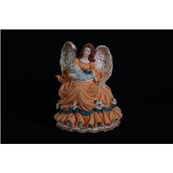 """A """"Guardian Angel"""" Porcelain Figurine."""