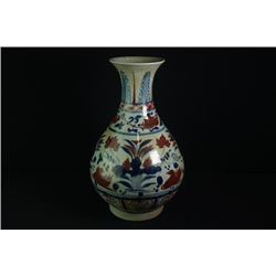 "A Blue-and-White and Underglazed-Red ""Floral and Birds"" Vase."
