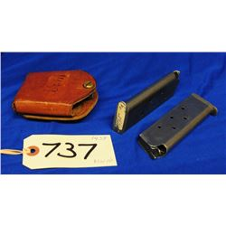 Two Colt 45 Auto mags with leather mag holster