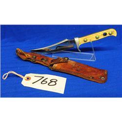 Puma Skinning knife in leather sheath