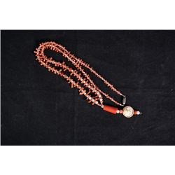 """A Precious Coral Necklace with """"Figure"""" Pendant."""