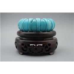 A Turquoise Bracelet.