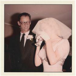 Marilyn Monroe and Arthur Miller candid wedding photograph by Milton H. Greene.