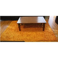 WOOD COFFEE TABLE WITH SHAG AREA RUG