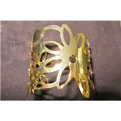 Gold floral design cuff bracelet