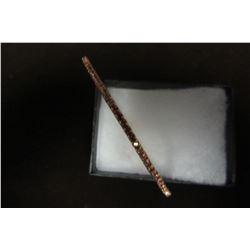Light pink swarovski crystal bangle in gold finish.