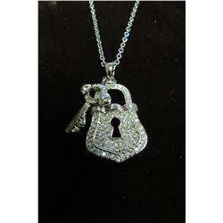 """SILVER AND CZ ACCENTED LOCK AND KEY PENDANT ON 17"""" NECKLACE."""