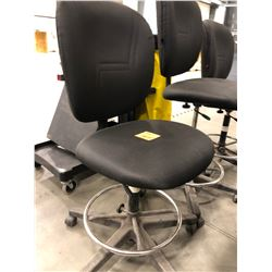 3 - Black office chairs with adjustable height, fabric shows wear