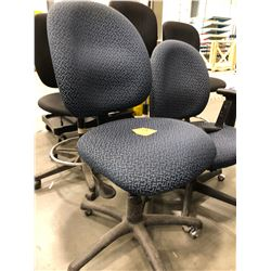 3 - Blue pattern office chairs with adjustable height. 1 chair has no arm rest
