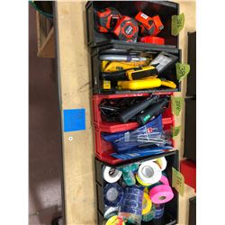 Assorted electrical tape, punches, utility knives, tape measures, cable strippers