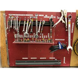 Tool board with storage includes sockets, wrenches, Allen keys, saw blades, face shield, dustpan