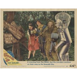 """The Wizard of Oz 1949 rerelease lobby card with """"Dorothy"""" and friends in the Haunted Forest."""