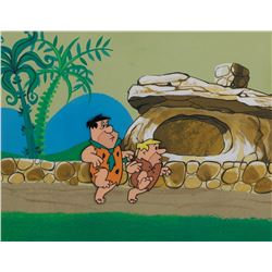 """Fred"" and ""Barney"" production cel on a matching production background from The Flintstones."