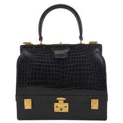 "Lady Oona Chaplin Hermes brand black Crocodile ""Sac Mallette"" bag with gold hardware."