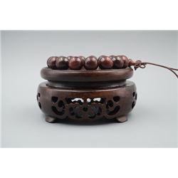 A Rosewood Bead Bracelet.