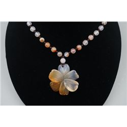 """A Deep Sea Agate """"Floral"""" Pendant with Bead Necklace."""