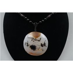 A Deep Sea Agate Round Pendant with Bead Necklace.