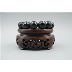 An Obsidian Bead Bracelet with 18mm Beads.