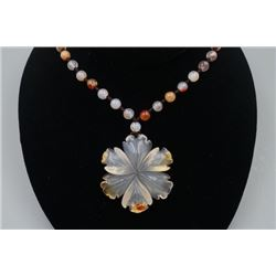 "A Deep Sea Agate ""Floral"" Pendant with Bead Necklace."