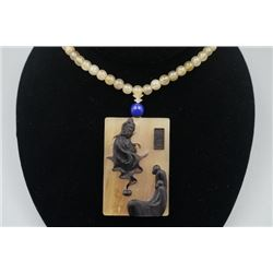 "A Antelope's Horn ""Wu Dao"" Pendant with Bead Necklace."