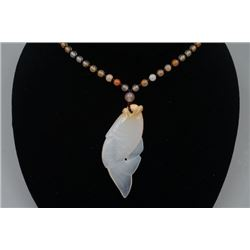 "A Deep Sea Agate ""Fish"" Pendant with Bead Necklace."