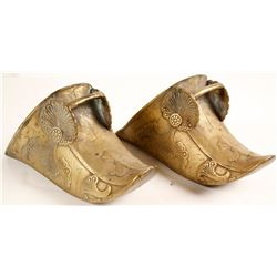 Pair of decorative brass shoes