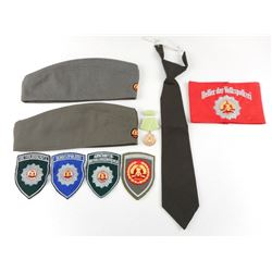 ASSORTED EAST GERMAN UNIFORM DECORATIONS & PIECES