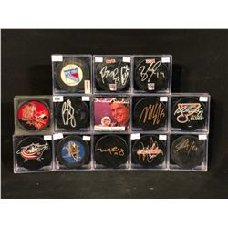 COLLECTION OF 13 SIGNED NHL AUTOGRAPHED TEAM PUCKS IN PROTECTIVE CASES, SEE PICTURES TO VIEW