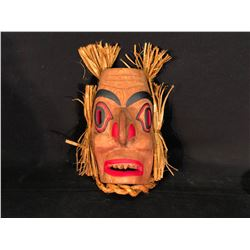 ANDY WESLEY OF TSU-ECH FIRST NATION, HAND CARVED AND PAINTED WILDMAN MASK WITH CEDAR BARK ACCENTS,