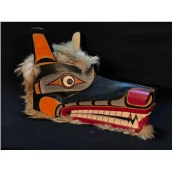 FINELY CARVED AND PAINTED FIRST NATIONS WOLF MASK, WITH WOLF PELT ACCENTS, APPROX. 20'' LONG, FROM