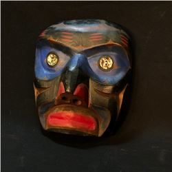 HAND CARVED AND PAINTED WILD MAN MASK WITH ABALONE BUTTON ACCENTS, ARTIST UNKNOWN, APPROX 9.5''
