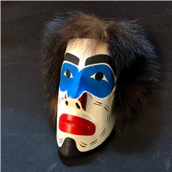 "MATT JAMES ""INTRUDER"" HAND CARVED AND PAINTED PORTRAIT MASK WITH FUR ACCENTS, FROM KWAGIULT FIRST"