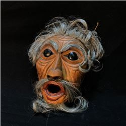 "L. BAINES ""CORKY"" HAND CARVED AND PAINTED PORTRAIT MASK WITH HORSE HAIR ACCENTS, CARVED IN 1987,"