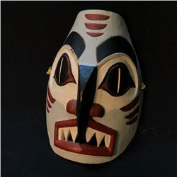 "ERWIN PAUL OF SQUAMISH FIRST NATION ""SAINDA"" HAND CARVED AND PAINTED MASK, APPROX. 10'' TALL,"