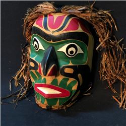 MANNY GEORGESEN HAND CARVED AND PAINTED WILD MAN MASK WITH CEDAR BARK ACCENTS, CARVED IN 1997,