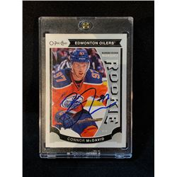 CONNOR MCDAVID AUTOGRAPHED O-PEE-CHEE ROOKIE CARD IN PROTECTIVE CASE