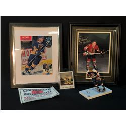 COLLECTION OF AUTOGRAPHED HULL FAMILY HOCKEY MEMORABILIA INC. PIECES SIGNED BY BOBBY HULL, BRETT