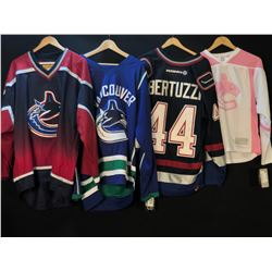 LOT OF ASSORTED CANUCKS JERSEYS
