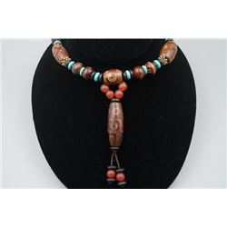 An Agate Barrel Beads and Dzi Beads Necklace.