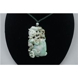"A Grade-A Jadeite ""Monkey"" Pendant with String Necklace."