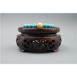 A Turquoise and Amber Round Beads Bracelet.