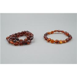 A Baltic Cherry Amber Necklace and Bracelet.