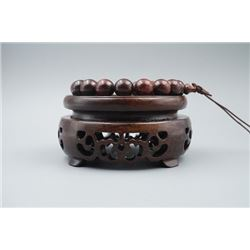A Rosewood Beads Bracelet.