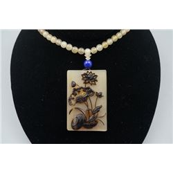 "An Antelope's Horn ""Lotus"" Pendant with Beads Necklace."