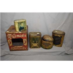 Four vintage and collectible tins including McCormick's biscuits, Mackintosh beehive toffee, Ivory G