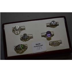 Six sterling silver rings including gemstone rings, claddagh, peace symbol etc.