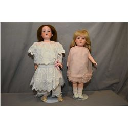 "Two antique bisque head dolls including Armand Marseille 390, 18"" painted bisque dolls with sleep ey"
