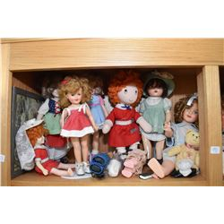 Shelf lot of vintage and collectible dolls including Shirley Temple, composition, hard plastic etc.