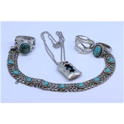 Selection of sterling silver and turquoise jewellery including pendant and neck chain, bracelet, two