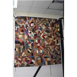 Antique handmade crazy quilt constructed by a group of fifteen church women for the Reverend and dat